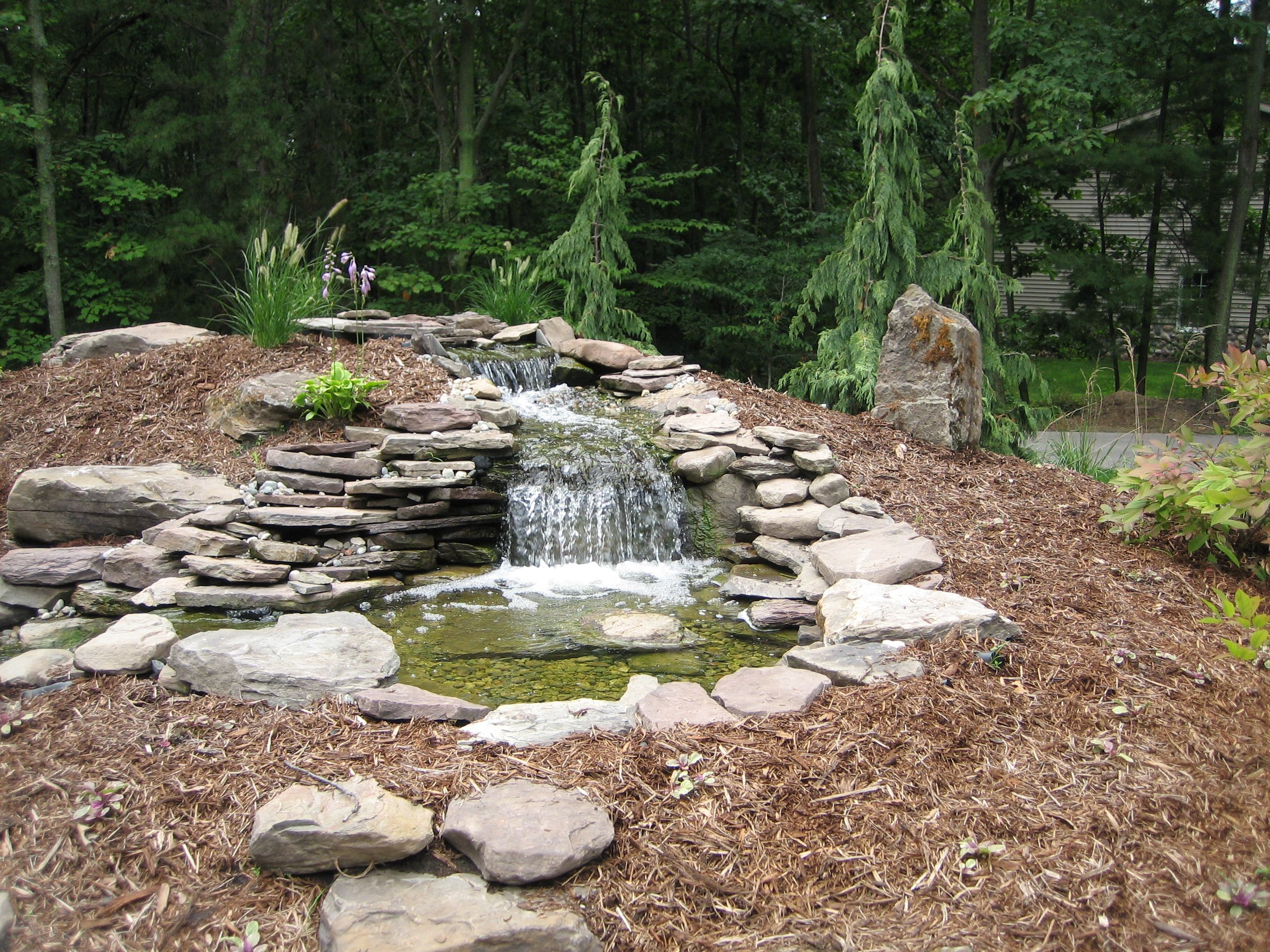 Landscape deign water runoff water feature 2592x1944 for Waterfall features