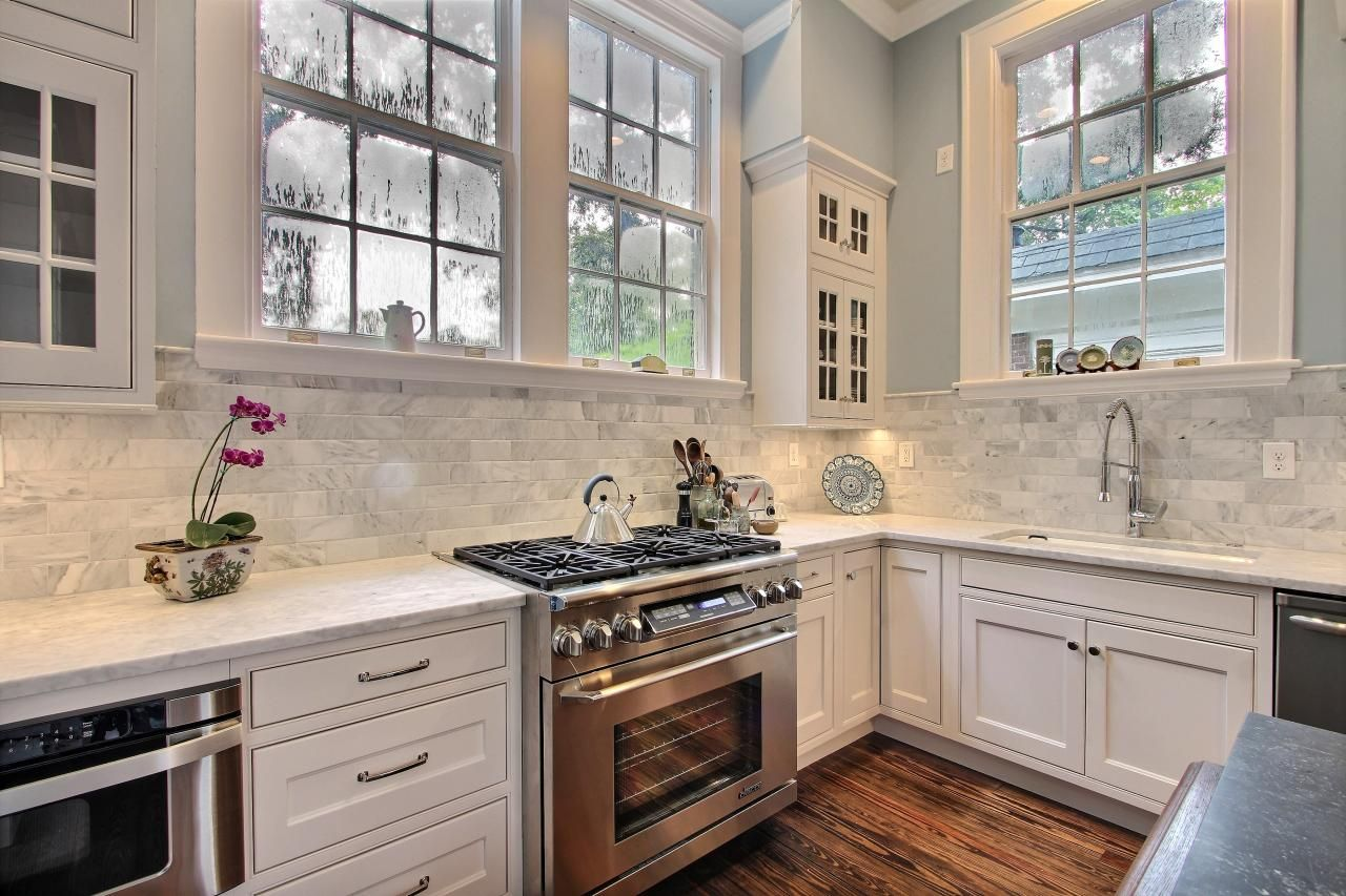 HGTV Features A Neutral Transitional Kitchen With Pale Gray Marble  Countertops And Backsplash, And Stainless Steel Appliances.