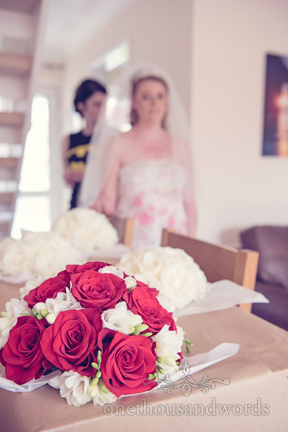 Red and white bridal bouquet from Simply Flower in Dorset. Photography by one thousand words wedding photographers