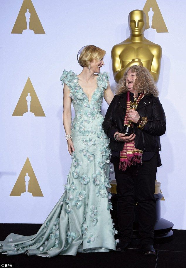 Jenny Beavan holds the Oscar for Costume Design for 'Mad Max: Fury Road' as she poses with Cate Blanchett in the press room