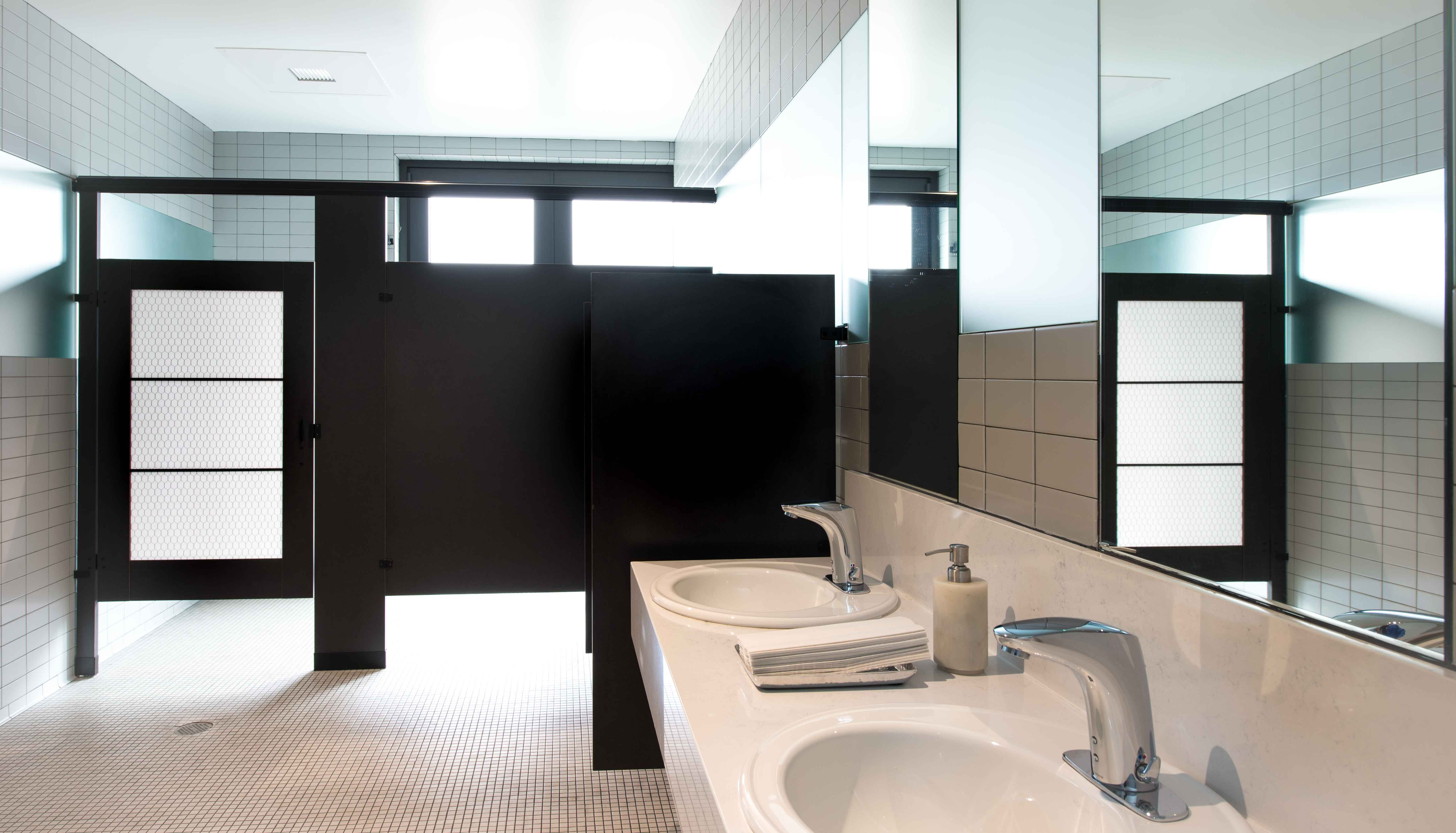 Ironwood Manufacturing laminate toilet partitions with engraved Door