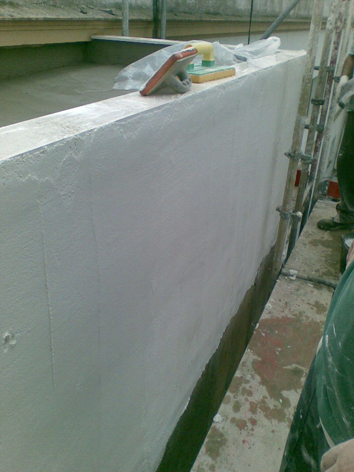 Revestimientos - Aplicación mortero monocapa blanco en fachada