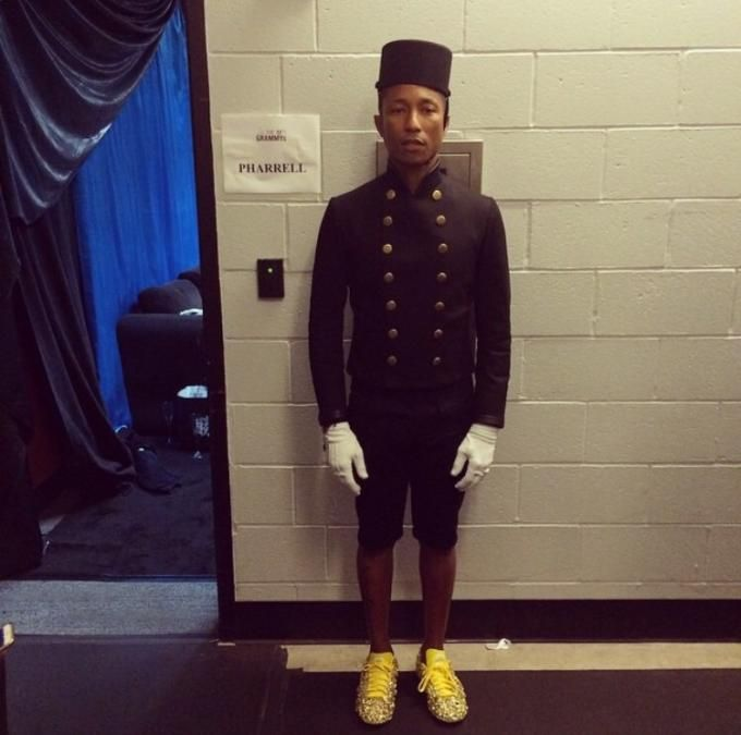 """Pharrell channeling the lobby boy from """"THe Grand Budapest Hotel"""" during his 2015 Grammys performance of """"Happy."""""""