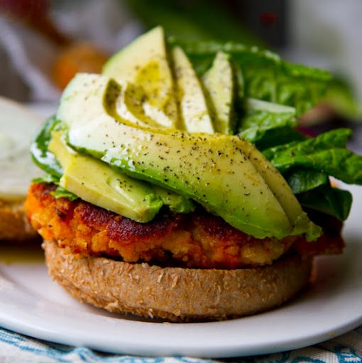 Sweet Potato Veggie Burgers with Avocado.  Don't think you have to be a vegan to think this looks de-li-cious. Going to put this one on the menu. mmmm