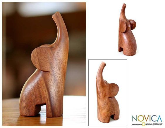 From Made Wirata, this sleek sculpture distills the essence of the elephant in a modern style. The suar wood sculpture is carved by hand with its trunk raised in a joyous trumpet.