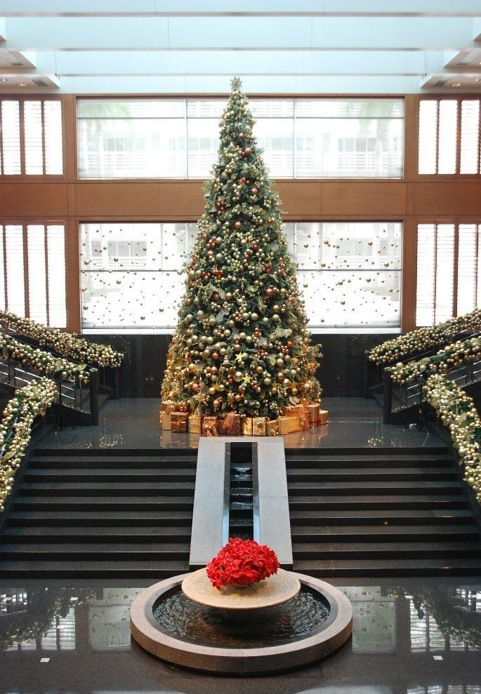 A Staircase Lined With Festive Foliage And Ornaments Leads The Way To Mandy Dewey Seasons Hotel Fun Christmas Decorations Christmas Decorations Christmas Tree