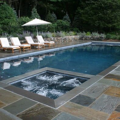 Hot Tub In Pool The Whole Thing Gets Covered By The Auto Pool Cover Stone Pool Deck Rectangle Pool Pool Patio
