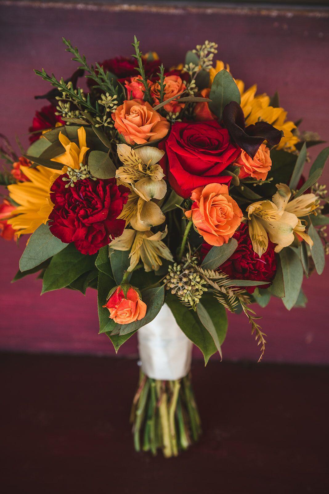 Benkens fall autumn bridalbouquet with roses alstroemeria