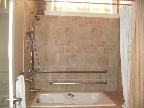 Sunken jetted tub/shower-combo shower & jacuzzi..it can be done ...