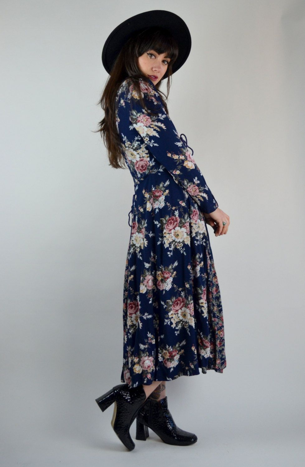e58a6fa819c Gorgeous 1990s Starina dress! Made in a navy blue rayon with a bold floral  print