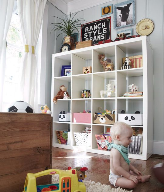 These shelves hold collectibles and art while baby is little, but can be filled with Big Kid toys later on. Love the bins with animal faces!