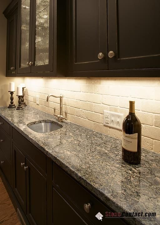Brownie Granite Espresso Kitchen Cabinet With Travertine Subway Backsplash Design