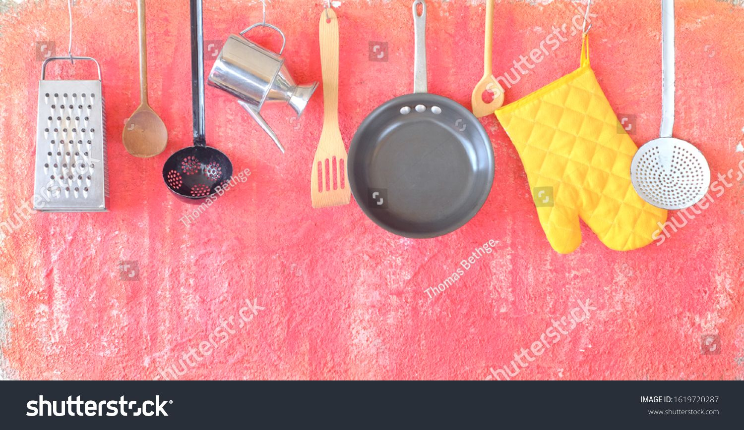 Kitchen utensils for commercial kitchen,food and drink, restaurant,cooking concept. Hanging items on grungy wall. #Sponsored , #Ad, #kitchen#food#drink#Kitchen