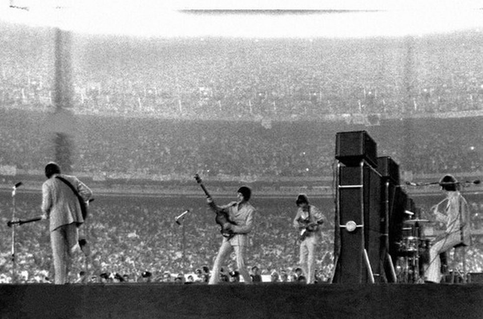 The Beatles at Shea Stadium, one of the first major stadium concerts in history with over 55,000 fans - 1965