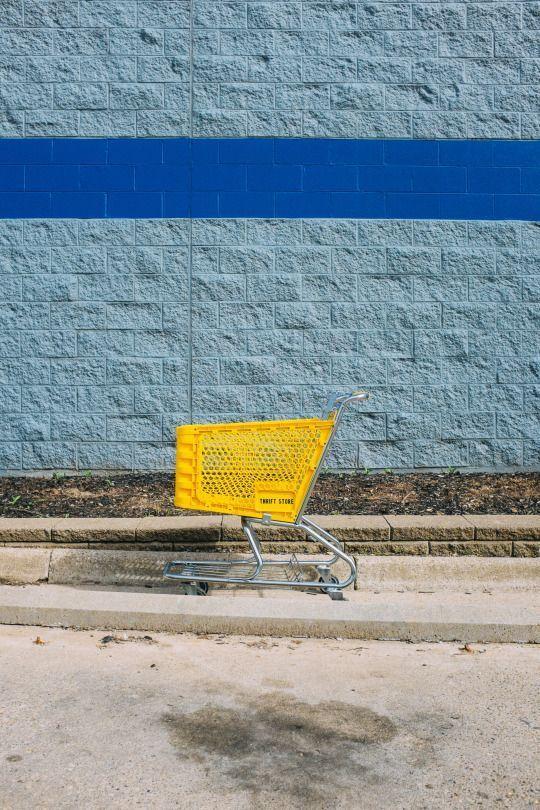 Adam Birkan M Yellow Shopping Cart Blue Brick Wall Fow