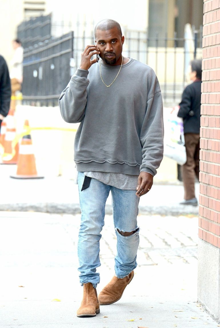 Kanye West Looking So Comfy Wearing A Grey Sweatshirt Ripped Jeans And Brown Boots Sweatshirt Outfit Casual Kanye West Outfits Most Stylish Men
