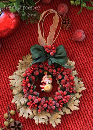 Cool idea with the glittered leaves... vintage feel.
