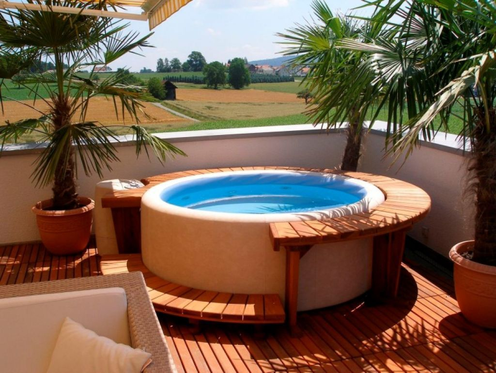 Outdoor backyard deck designs with hot tub ideas Rectangle vs round pool