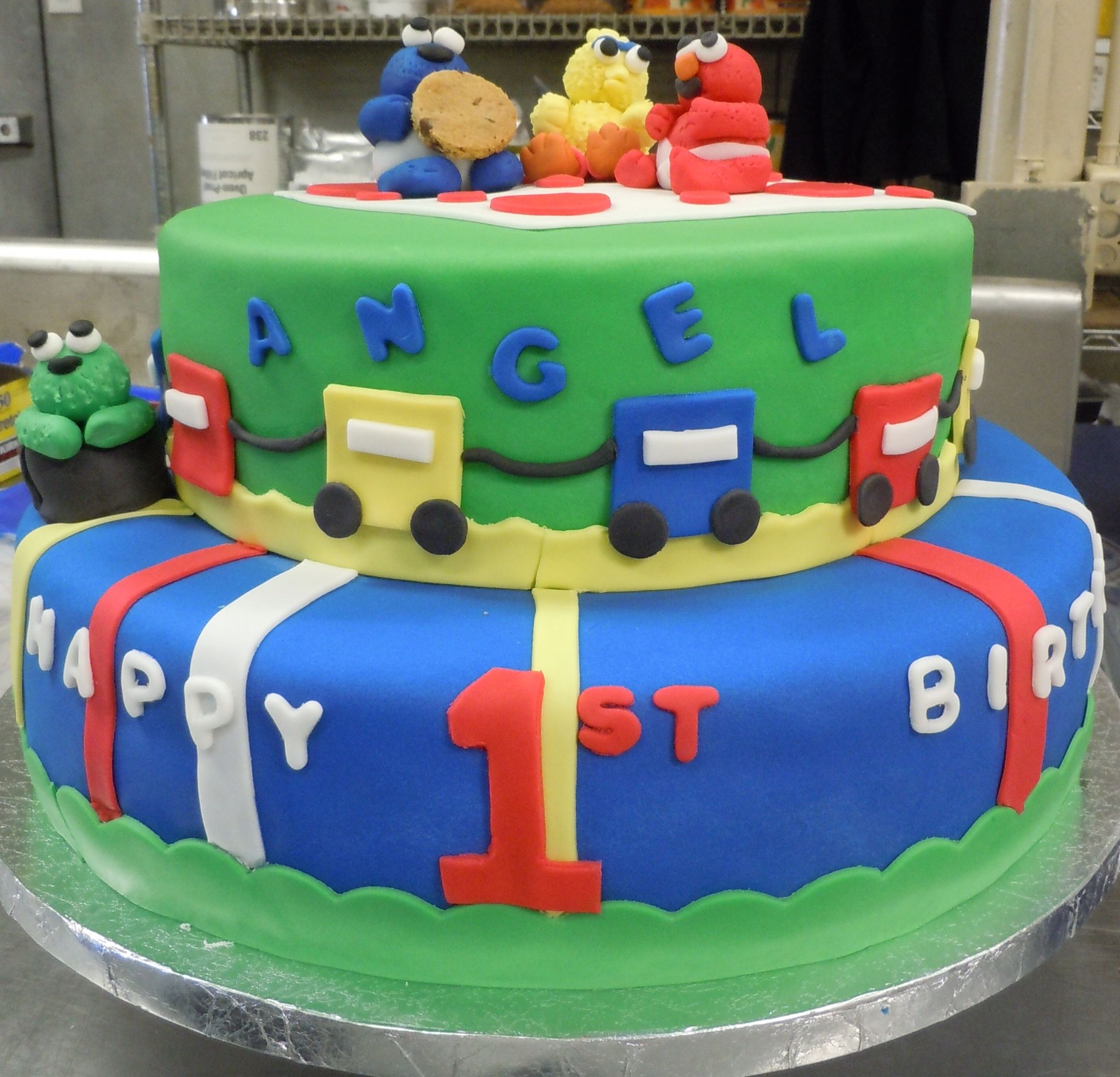 Fondant covered Sesame Street cake with fondant figures of Cookie