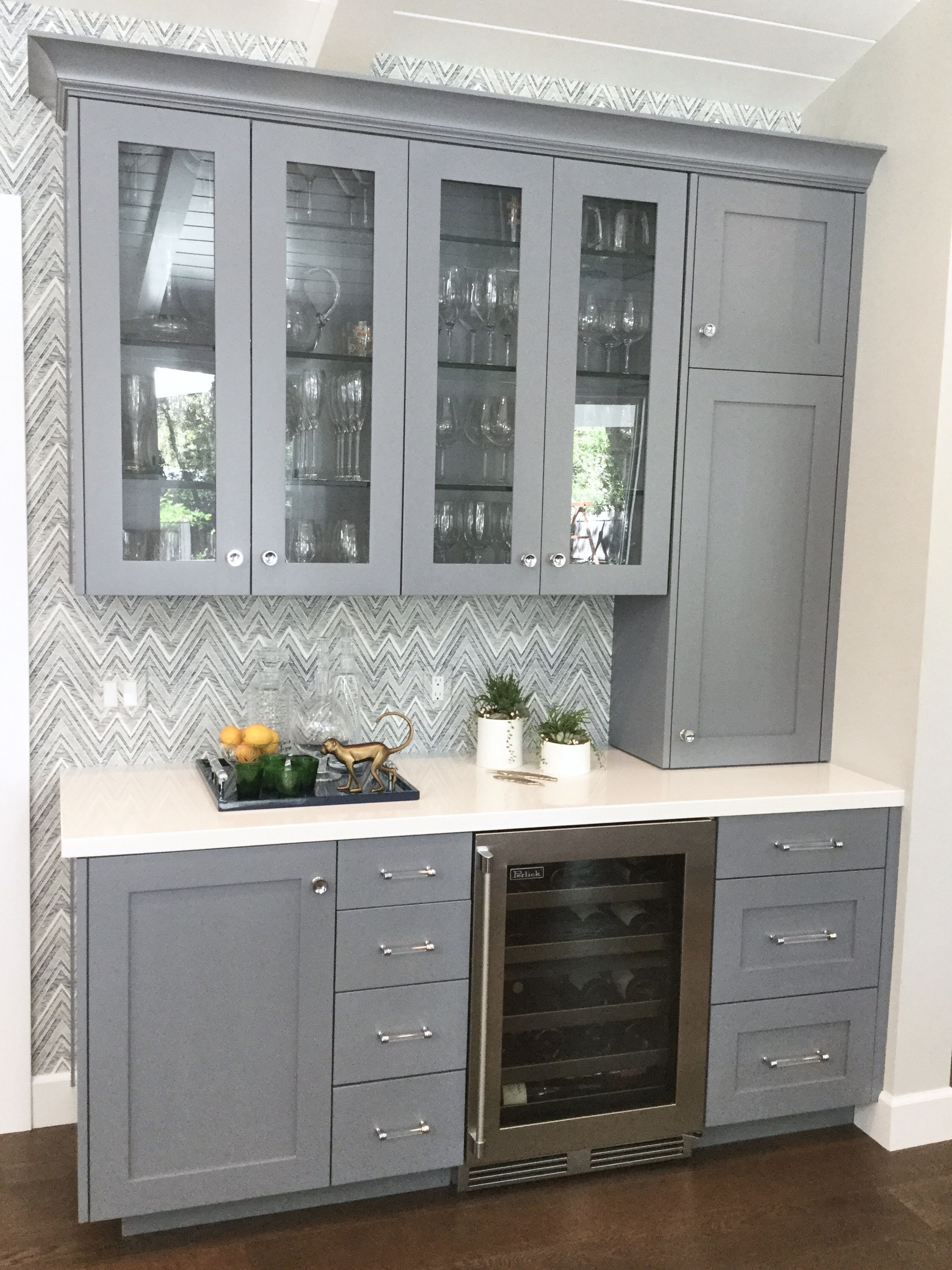 Custom Built In Bar With Grey Cabinetry And Wallpaper Backsplash