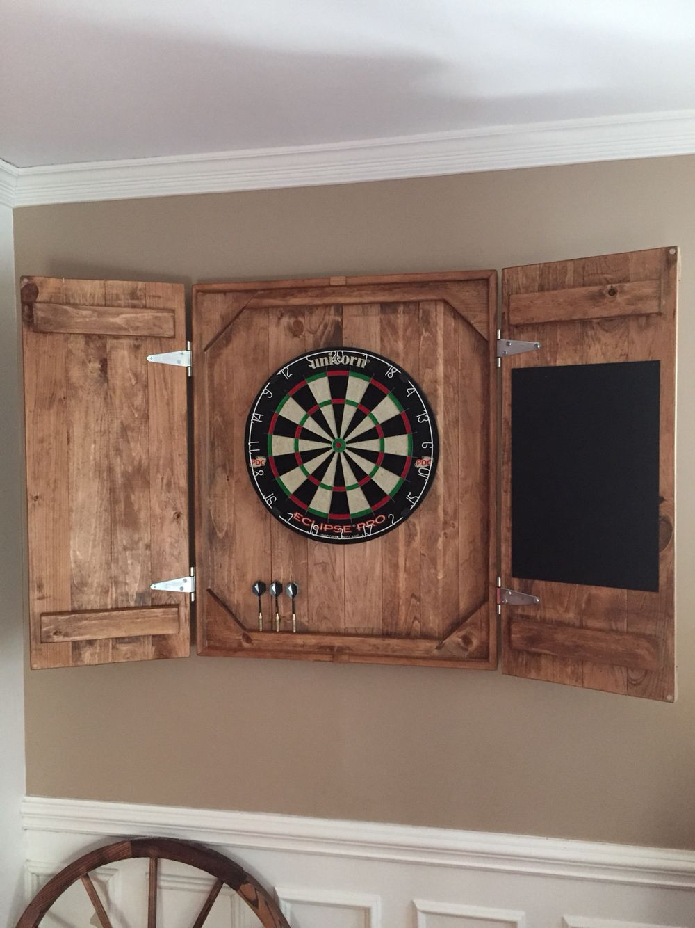 diy dart board case put chalkboard and chalk holder on one side dart holder on other and corks as dart backboard also put a design on wood wood