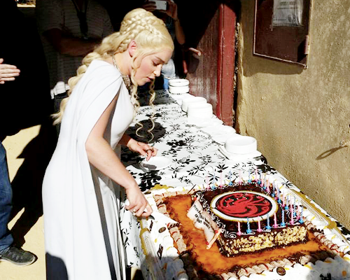 Game of Thrones:  Emilia Clarke cuts her birthday cake on the set of Game of Thrones season 5 in Osuna, Spain; October 23rd 2014