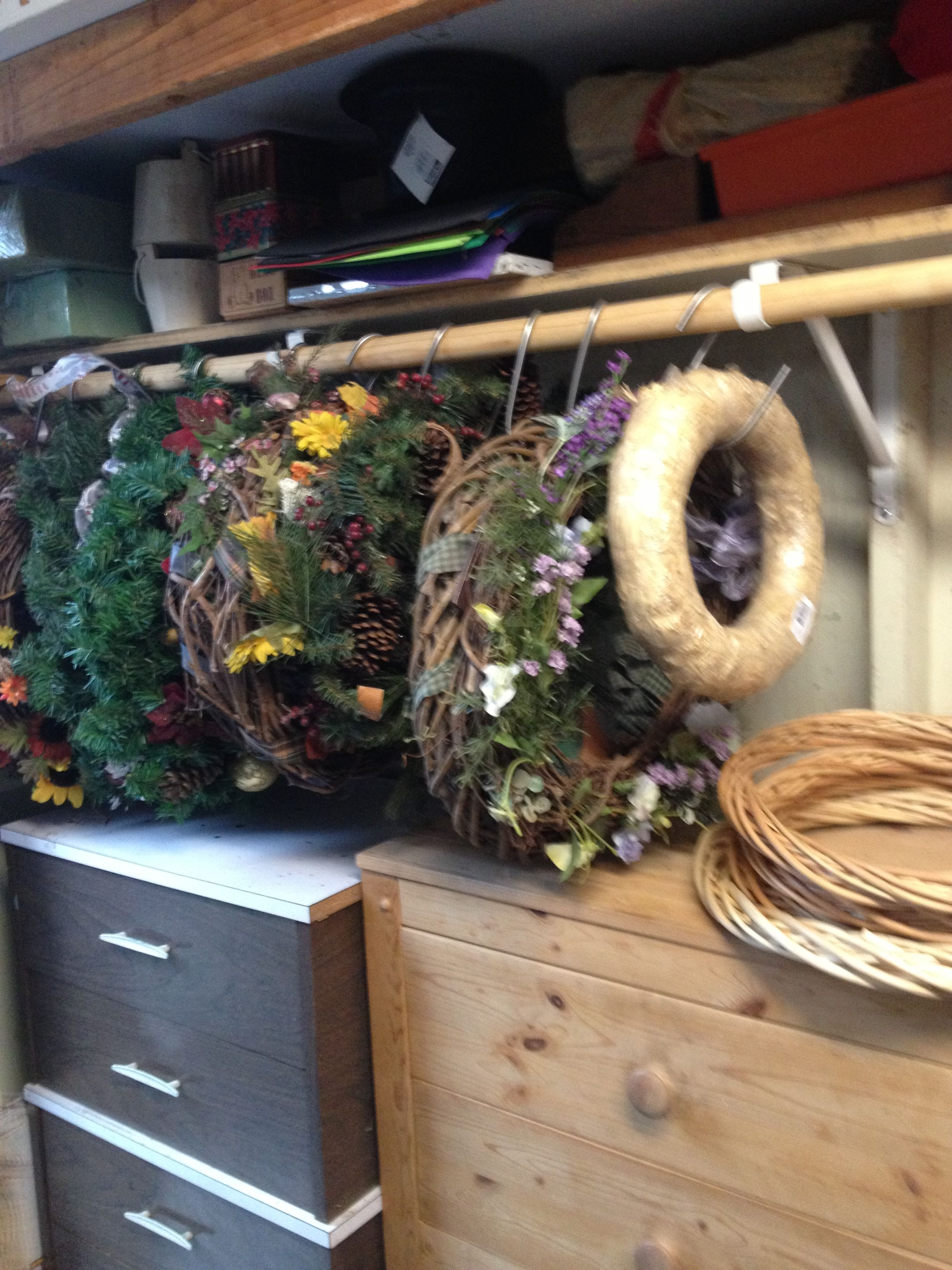 Storage for wreaths going to use a clothesline in storage for Attic storage bow