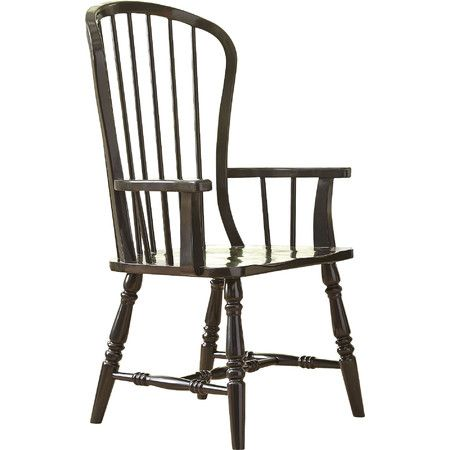 The high Windsor back of this wood arm chair makes it a handsome addition to the dining room or breakfast nook.  Product: Chair