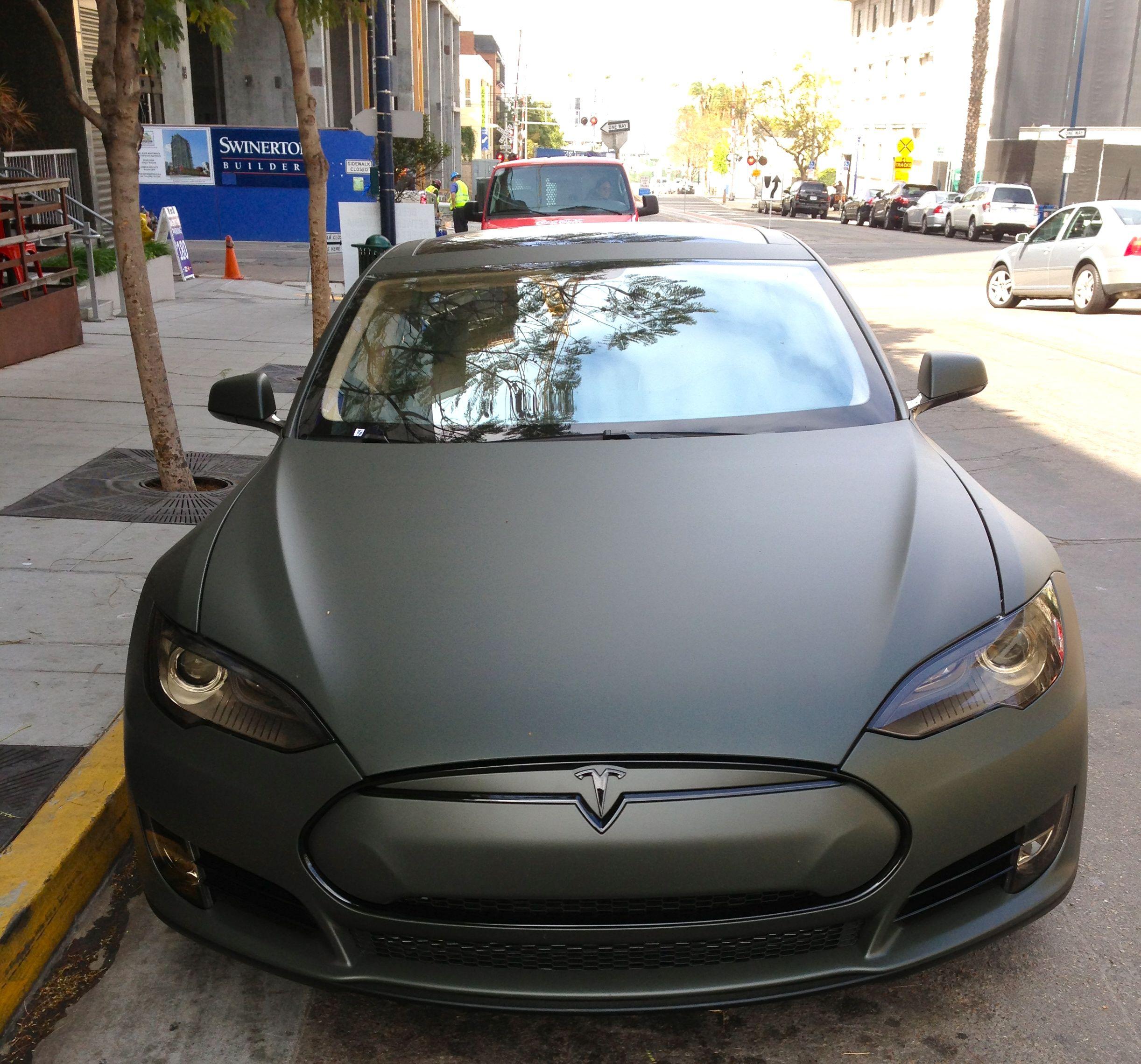"Tesla Motors Images Tesla Model S Larson Sketches: ""Tesla In The Wild"" With Matte Black Finish! For More"