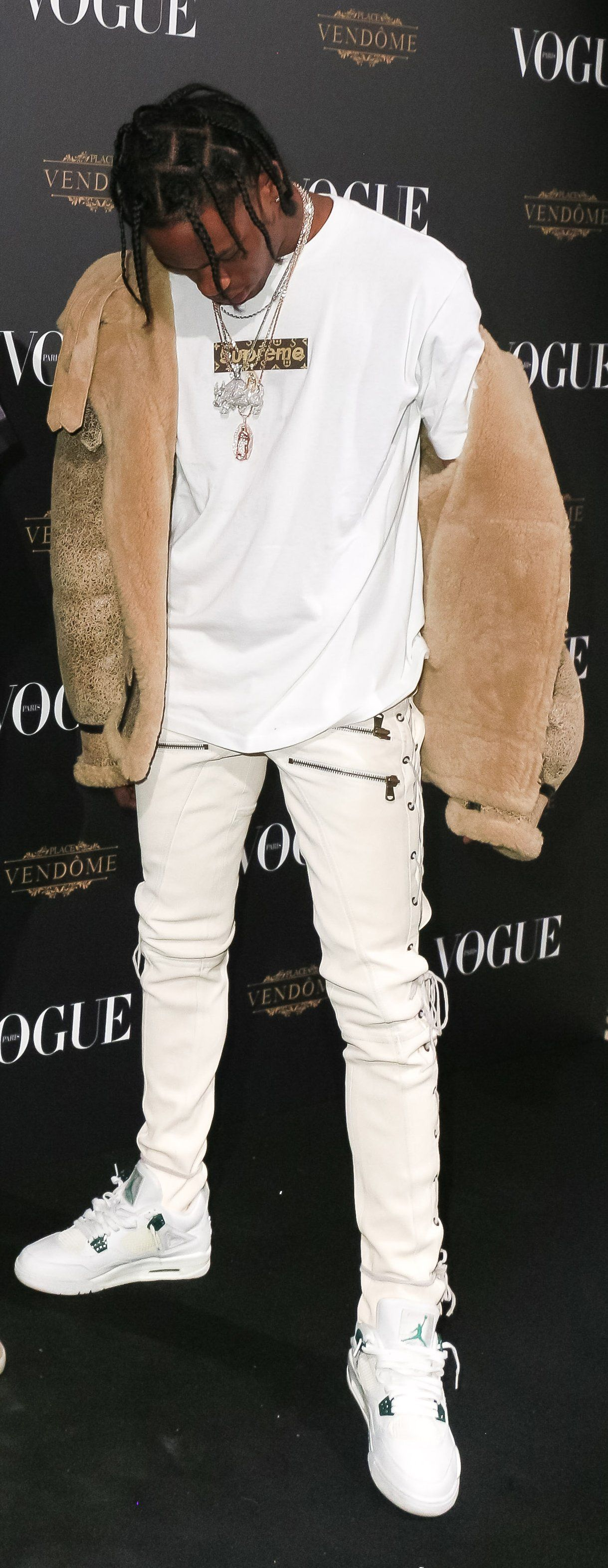 64030edf51f5 Loving this outfit from Travis with the LV Supreme tee, fur jacket and and  white J's on white denim...clean
