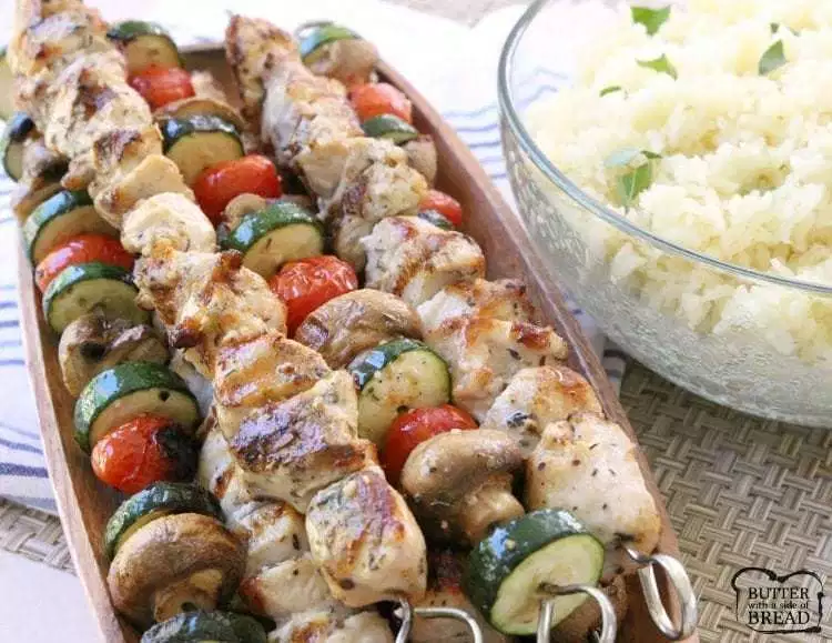 Simple recipe for Greek Chicken Souvlaki grilled to perfection and served with Greek lemon rice. Perfect weeknight dinner for anyone who loves the fresh, bright flavors of Greek food. #greeklemonrice