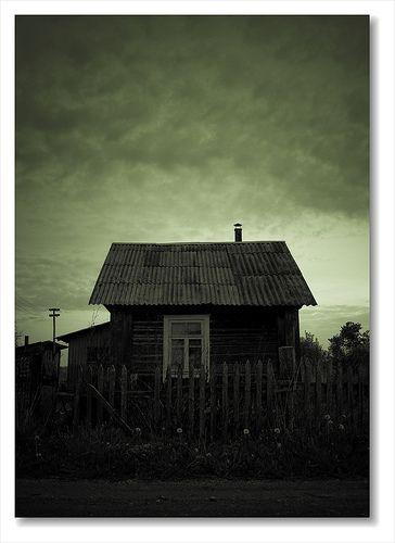Small house against a dark sky....