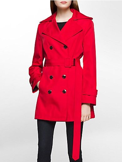 a stylish trench coat featuring a double breasted design, a collar with shoulder epaulettes, a d-ring tie-belt and side pockets in a fully lined style.