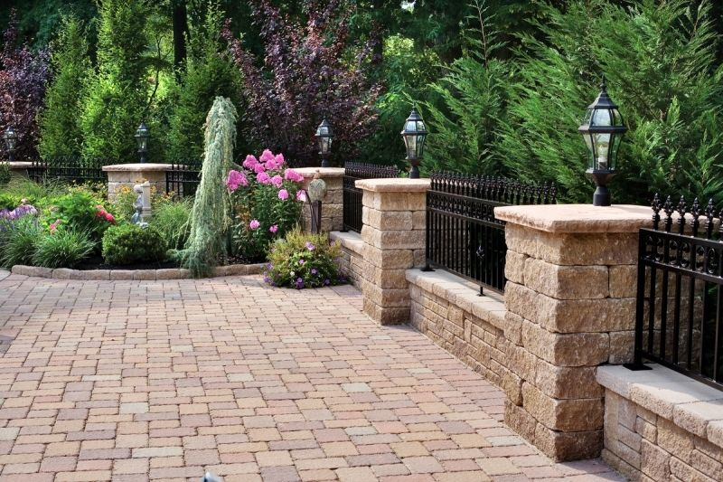 The Wrought Iron Railing On Top Of The Knee Wall Between The
