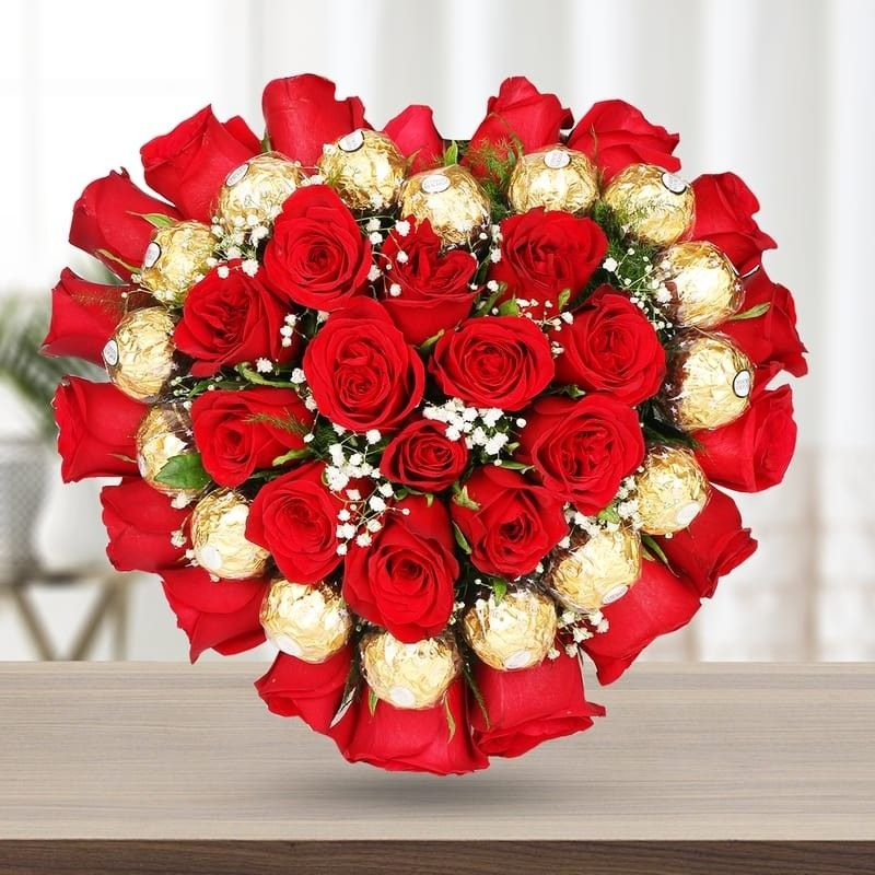 Red Ferrero Heart A Heart Shape Arrangement Of Red Roses With Ferrero Rocher Flower Arrangements Diy Flower Delivery Red Roses