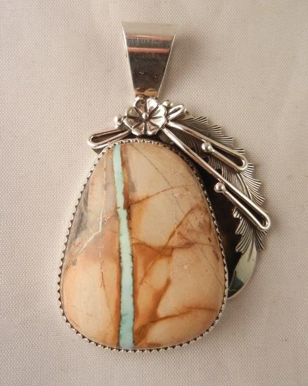 #pendant with Royston Ribbon #turquoise stone set in sterling silver bezel embellished with flower and feather design by #Navajo silversmith Peterson Johnson