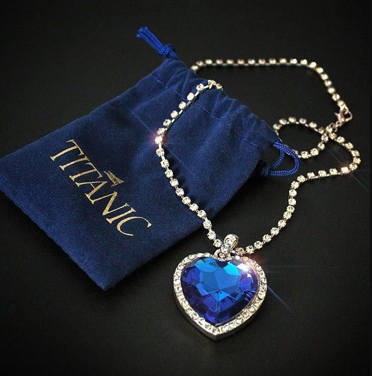 """This heart of the ocean titanic necklace is absolutely adored by everyone who receives it. It's a one of a kind way to show someone that they mean the world to you. Give this beautiful gift to somebody you love, somebody who loves you, or a dear friend. Specification Length: 45cm Weight : 26gPendant size : 34mm * 45mmSurface processing : Platinum platingMetals Type : Zinc alloy Bonus: It comes with the velvet bag!! """"I love everything on your store, the jewelry is absolutely beautiful!"""" ★★★★★ Ama"""