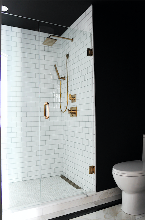 Chic Black And White Bathroom Features Black Walls Framing A Seamless Glass Shower Clad In White Subway Sur White Subway Tiles Black Walls White Bathroom Tiles