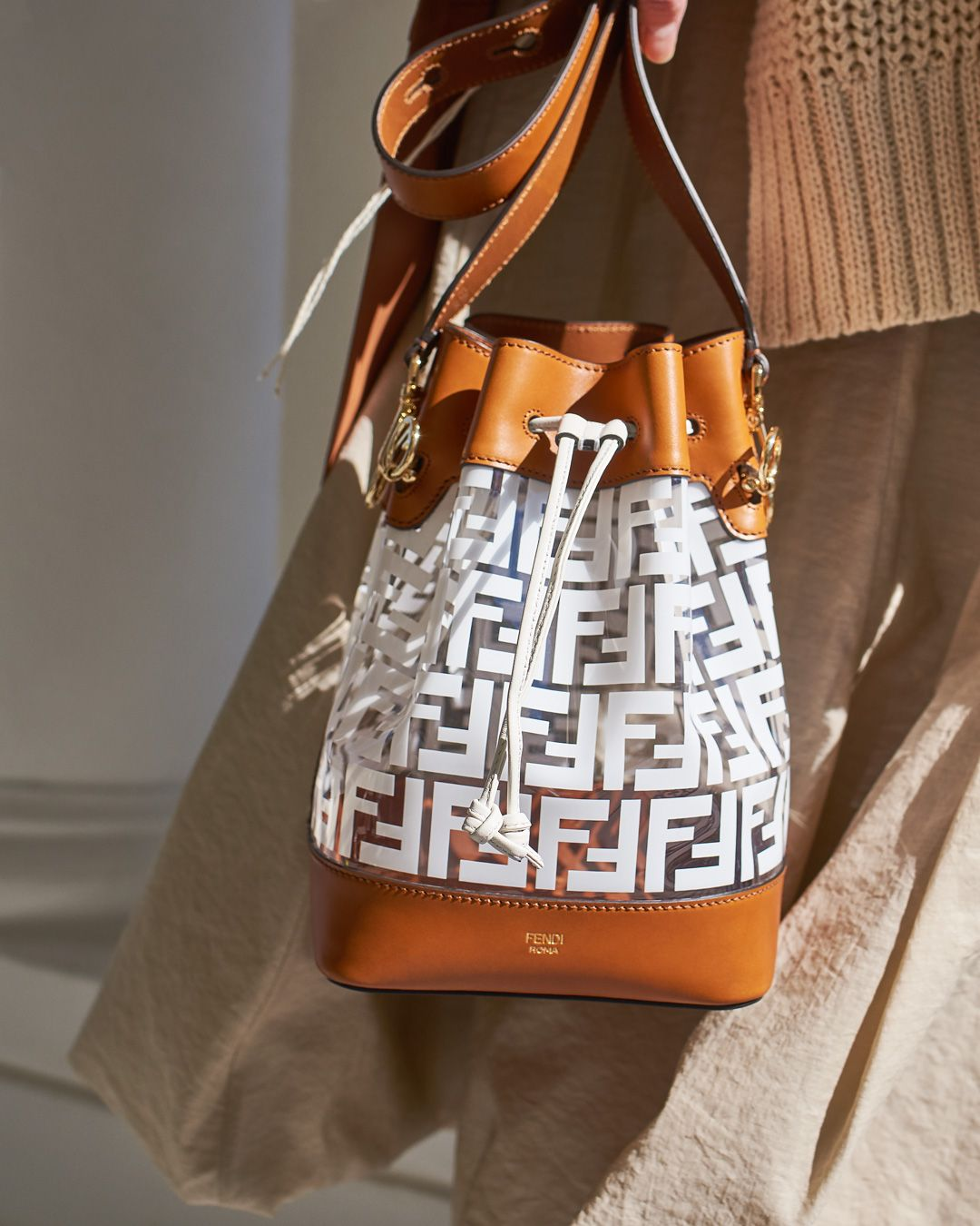 80bb3336b86 This treasure of a bag has us falling in love with  fendi s FF monogram  print all over again. Shop the Mon Tresor bucket bag via the link.