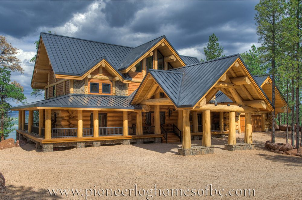 View pioneer log homes 39 gallery of images of handcrafted for Wood cabin homes