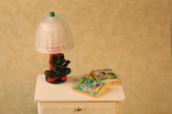 A table lamp  from a pen,  a button and a cup of a soap bottle