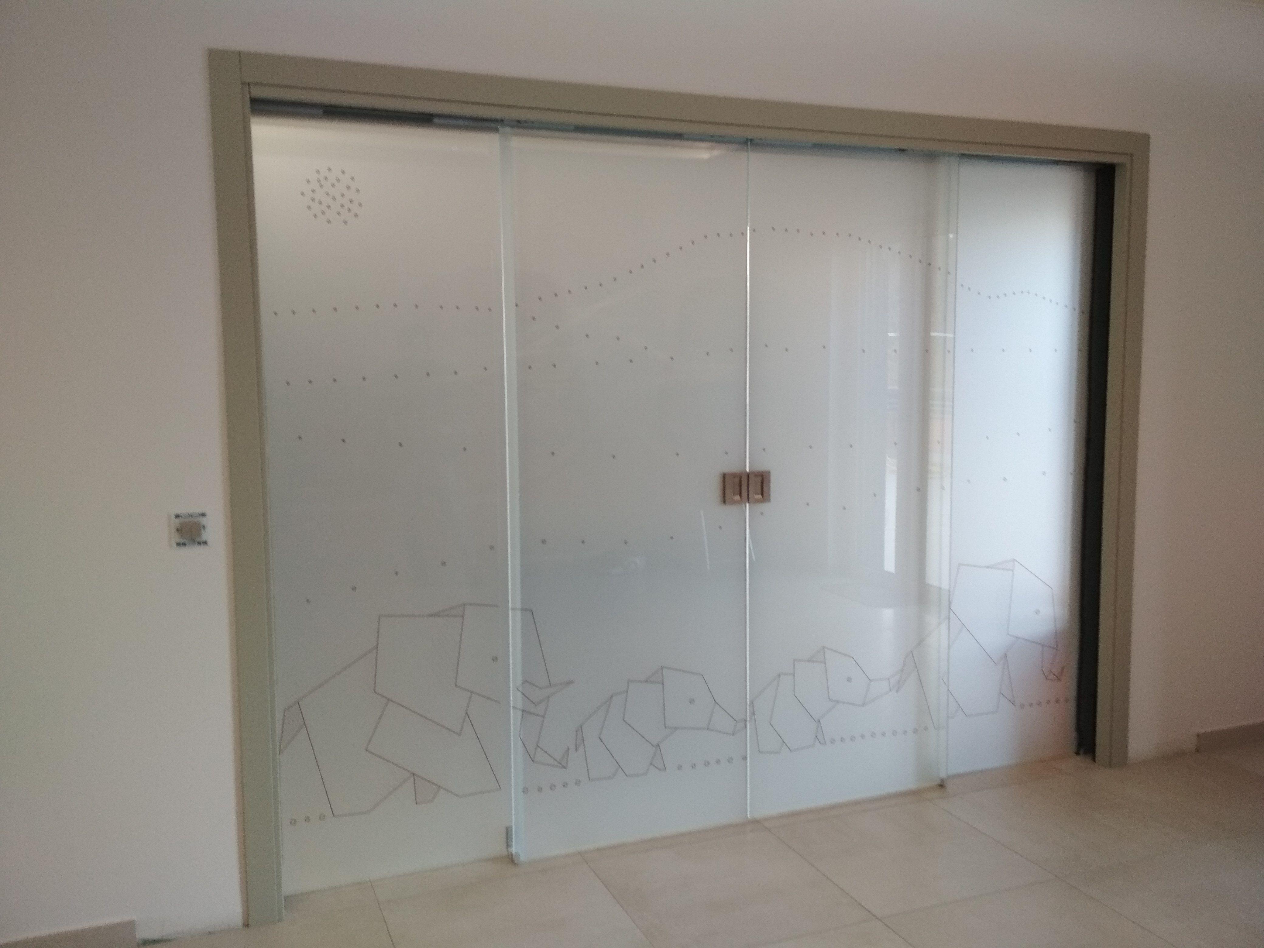 Rolmatic Corner Glass Door - Jersey Street  Architectural -