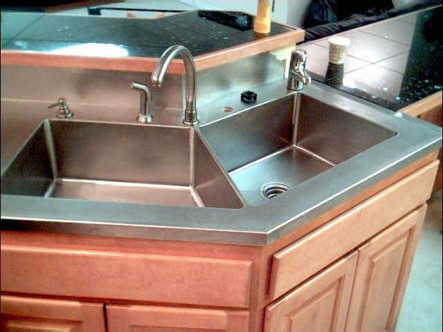 Stainless Steel Countertop With Marine Edges And Integrated Sinks