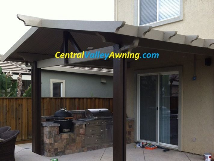 Gabled Roof Patio Cover With Recessed Light Yes This Really Is Aluminum With A Wood Grain Texture A Aluminum Pergola Pergola Plans Diy Aluminum Patio Covers