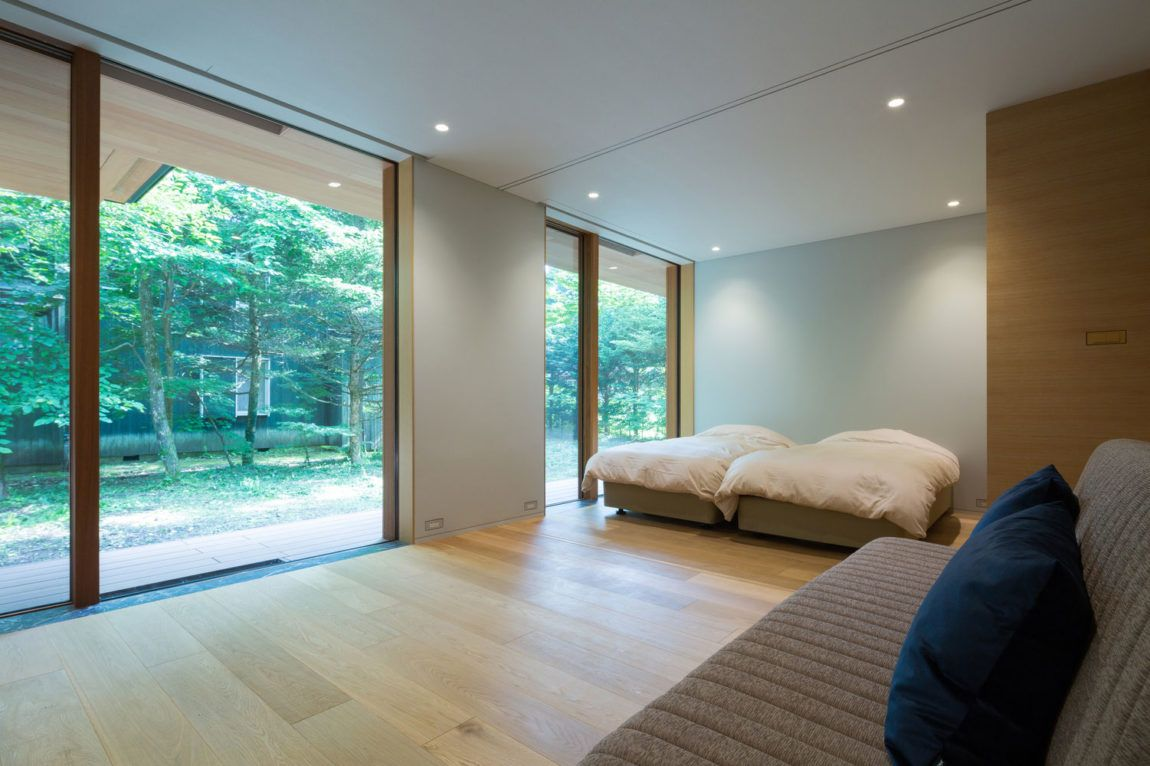 Interior design for double bedroom flat hidden among tall trees this house promises relaxation and
