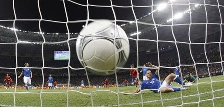 Italy's Leonardo Bonucci lies on the pitch after Spain's Juan Mata scored the fourth goal during the Euro 2012 soccer championship final between Spain and Italy in Kiev, Ukraine, Monday, July 2, 2012.