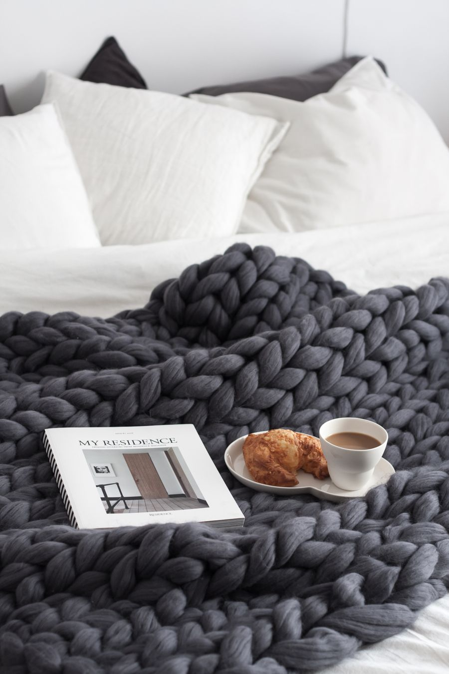 What a perfect setting for breakfast in bed. Love that large knit blanket! Wonderful Sunday mornings.