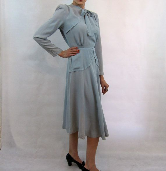 Lovely 40s Dress with Pussy Bow and Details by hautemoll on Etsy.  This IS lovely...