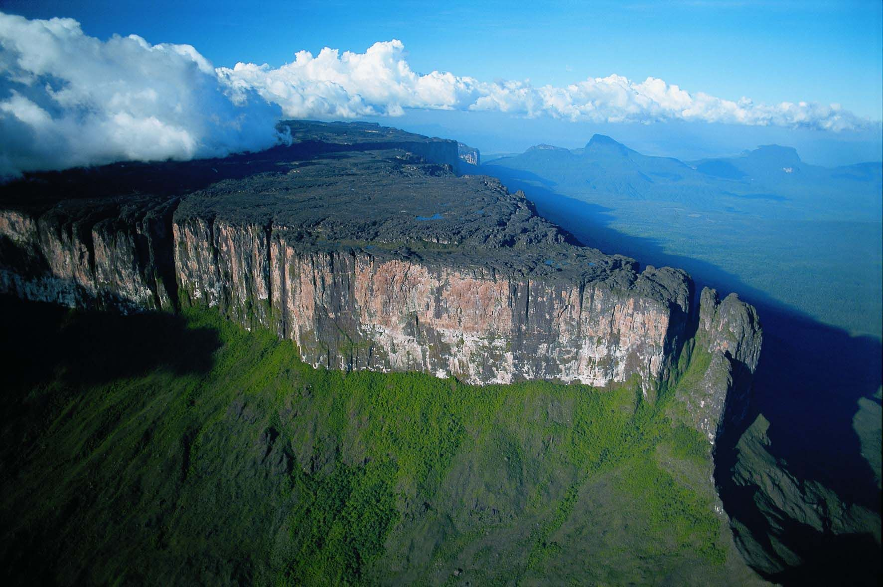 Canaima National Park, Venezuela: Breath-taking scenery characterised by table-top mountains [known as 'Tepuis'], savannah and many waterfalls including 'Angel Falls', the worlds highest uninterrupted waterfall, make Canaima National Park a beautiful stop on an itinerary to Venezuela.   Enjoy an overflight of Angel Falls where you fly over the sheer cliffs and view the waterfall from the top and from the bottom, a spectacular experience.