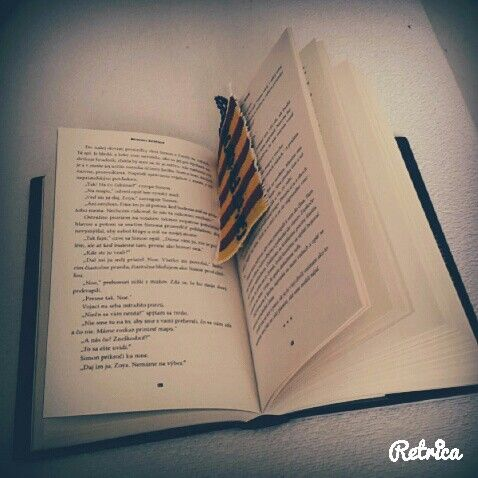 Reading with my Gryffindor bookmark ♡♥♡